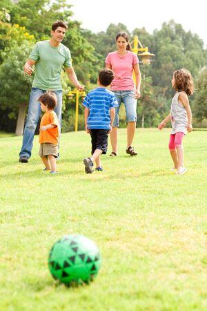 Family enjoying football on a sunny afternoon photo