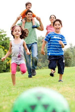 family park: Family having fun outdoors Stock Photo