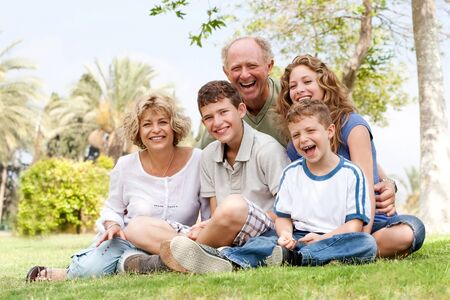 Happy family having fun in the park, smiling and enjoying sunny day Stock Photo