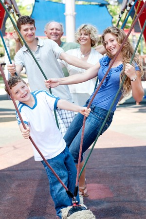 actively: Family of five actively enjoying swing ride