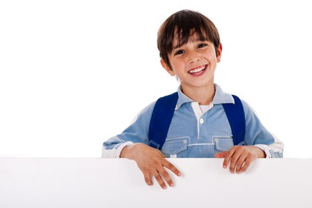 Young school kid standing behind the blank board isolated on white background Stock Photo
