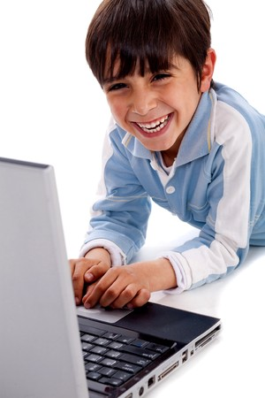 Cute smiling caucasian kid with laptop on isolated white background photo