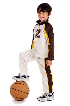 balls kids: Cute junior boy basket ball player leg over the ball on isolate white background Stock Photo