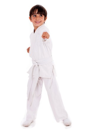 Small karate boy in training isolated white background photo