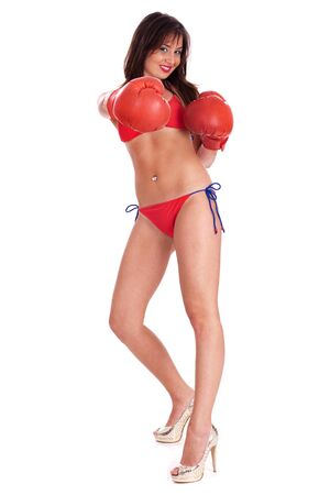 Sexy bikini boxer wearing gloves and posing in style against white background photo