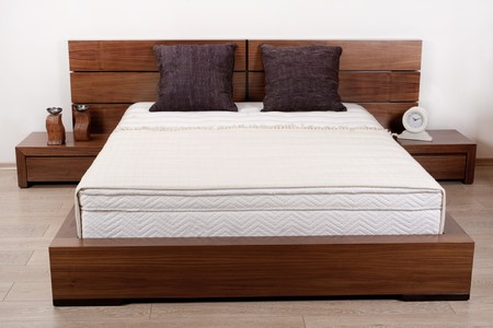 bedsheets: Modern wooden finished double bedroom