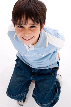 Top view of cute kid sitting over isolated on white background,ariel view photo