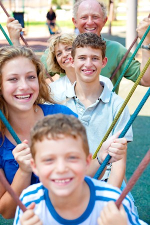 Closeup portrait of a happy family standing together and swinging in a line photo