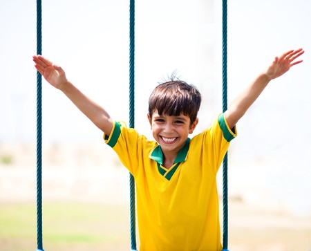 arms wide open: Little boy having fun as he runs with arms wide open