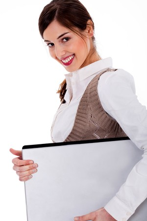 Portrait of lady holding laptop against an isolated background photo