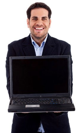 Portrait of young man holding laptop against an isolated background photo