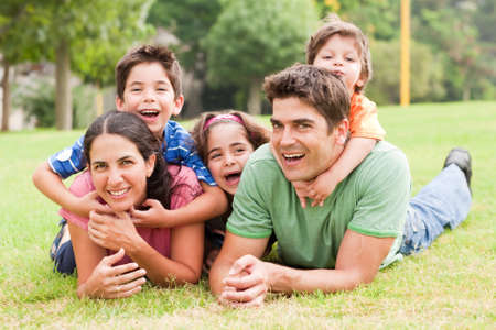 Family lifestyle portrait of a mum and dad having fun with their kids photo