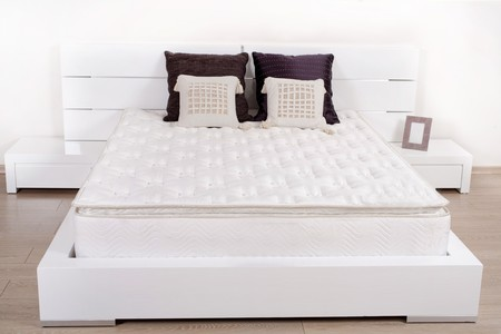 Elegant fancy white bedroom with double bed photo