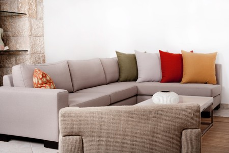 couch: Modern couch withe coloured pillow Stock Photo