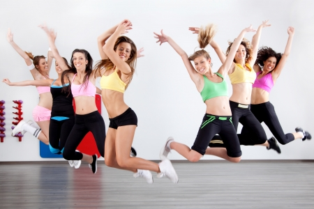 aerobic training: group of ladies working out in aerobic class