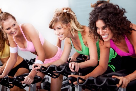 image of women at the gym doing cardio exercises photo