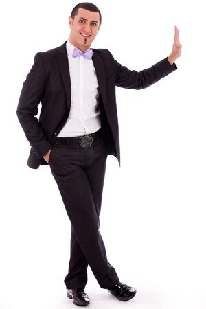 Full body portrait of a business man standing against the wall in a isolated white background photo