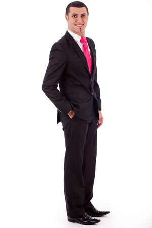 Stylish business man posing to the camera on a white isolated background photo