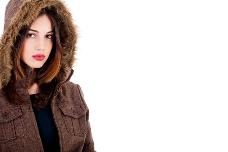 overcoat: fashionable young lady wearing overcoat on an isolated background Stock Photo