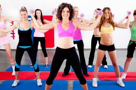 image of women doing aerobics with dumbbell photo