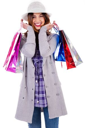 shoppings: Portarit of smiling lady posing with shoppings bags in her both hands Stock Photo