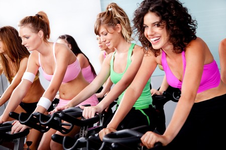 cardio fitness: image of group of people doing spinning in a gym Stock Photo