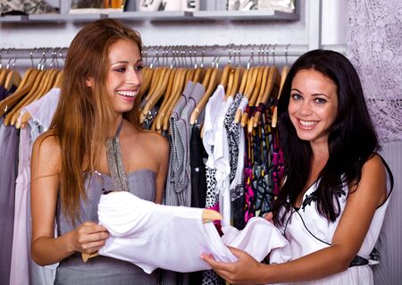 Sales assistant smiling and posing to the camera as she helps the buyer Stock Photo - 7957765