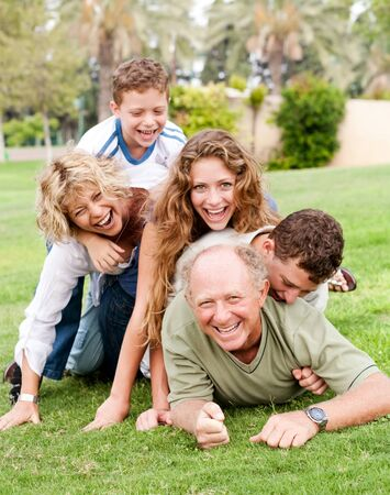 A family of five enjoy a beautiful afternoon at the park photo
