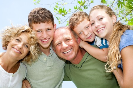 portrait of happy smiling family looking at camera photo