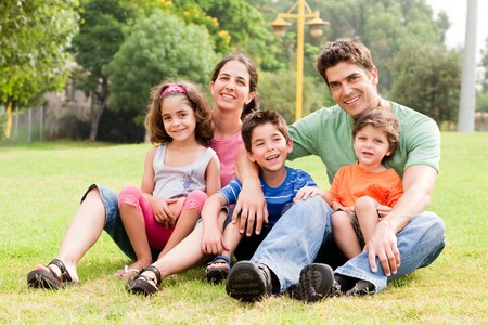 Family sitting in the summer park and enjoying sunny day Stock Photo - 7957782