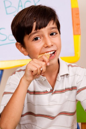 Close-up of school boy enjoying his lunch meal photo