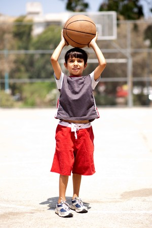 balls kids: Young boy ready to shot basketball, outdoors Stock Photo