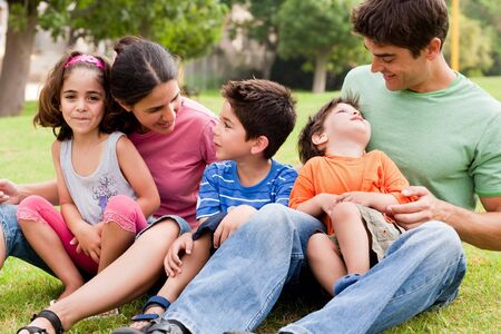 Happy family enjoying summer day in the park and having fun Stock Photo - 7957738