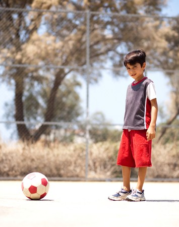 Young player ready to play soccer, outdoors photo