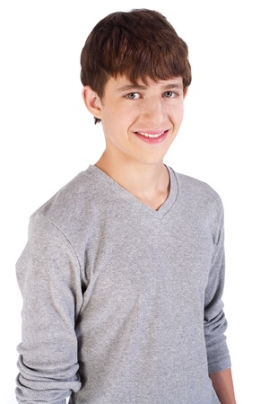teenage boy: Adorable handsome young boy posing and smiling at camera.