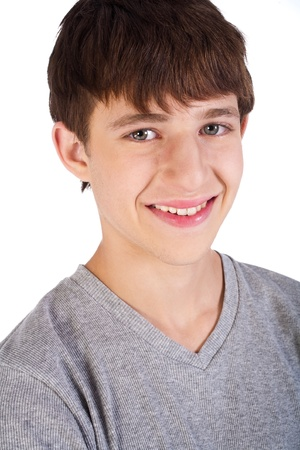 Close-up of hadnsome young boy smiling at camera. photo