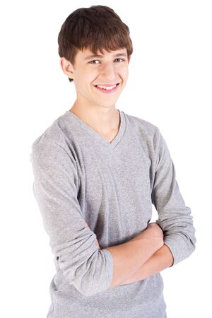Handsome caucasian teenager posing with crossed arms.. Stock Photo - 9796191