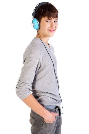 Teenager with headphones isolated over a white background. photo