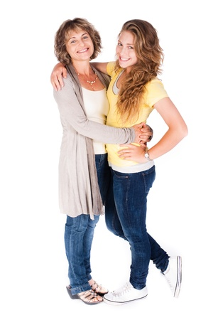 mother and daughter: Mother and daughter embracing each other isolated on white background.