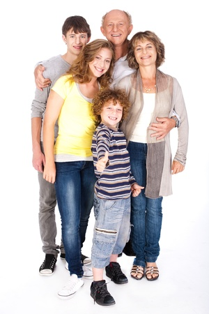 Thumbs-up family posing in style, indoors agianst white background.