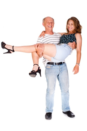 Father holding her daughter in studio against white background. photo