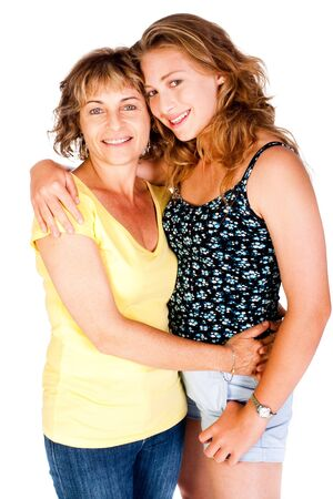 Mother and daughter embracing each other isolated on white background.. photo