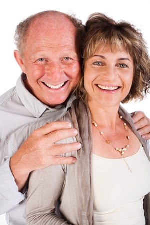 Attractive old couple posing as man hugs his wife from behind, isolated on white background. photo