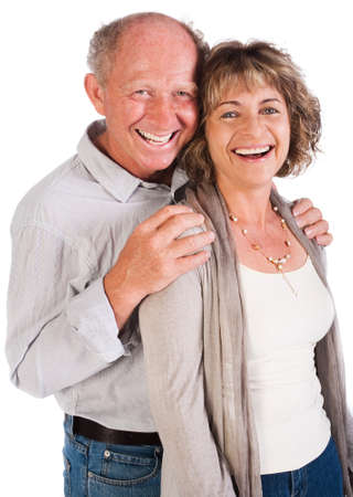 Senior couple posing in studio and smailing at camera. photo