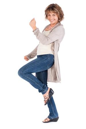 Full length portrait of senior woman isolated over white background. . Standard-Bild