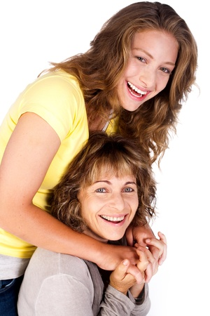 mum and daughter: Portrait of smiling matured mum with her daughter isolated over the white background..
