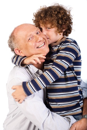 Grandfather and grandson cuddling over the white background.