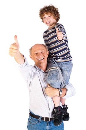 Thumbs-up pair of grandfather and grandson isolated on white background. Stock Photo