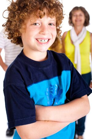 Young cute boy in focus with family in the background, isolated over white. photo