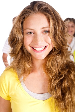 Gorgeous young woman smiling at camera, closeup, with her parents in the background.. photo